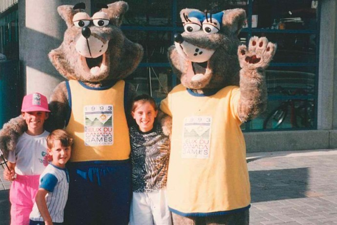 Nelson's kids stop for a photo with the two mascots of the 1993 Canada Summer Games in Kamloops, B.C.