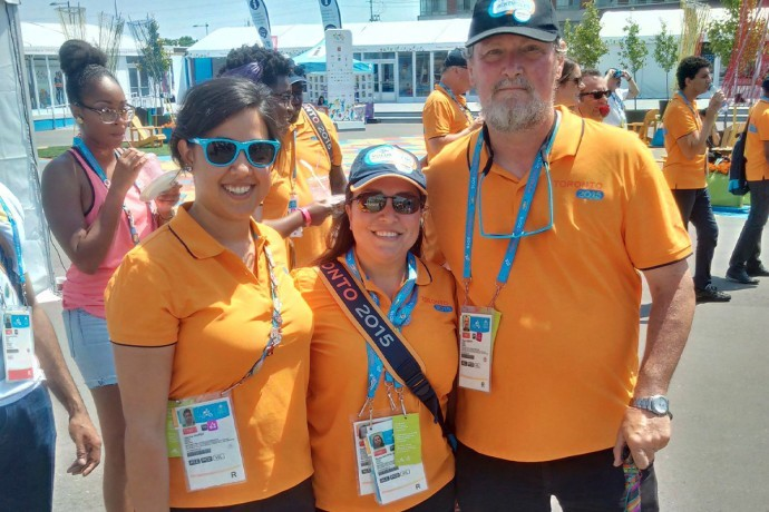 Hébert's (right) poses for a photo in the Athletes Village with fellow volunteers during the 2015 Pan American Games in Toronto